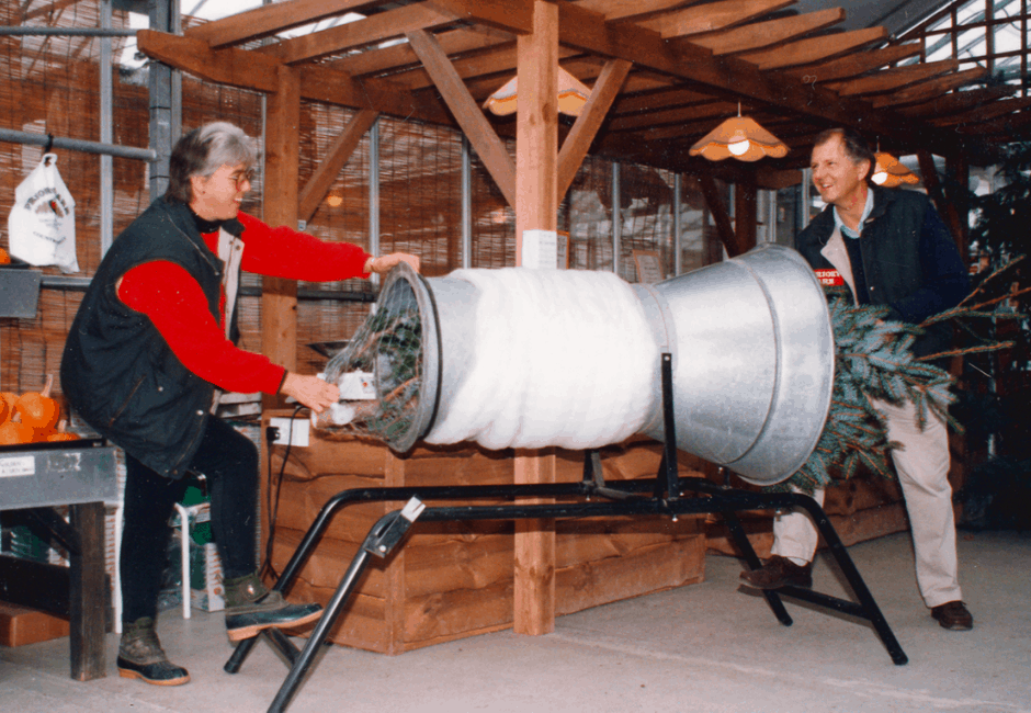 Frances Hallowes and Peta Marshall enjoying the new Christmas tree wrapping machine in 1994.