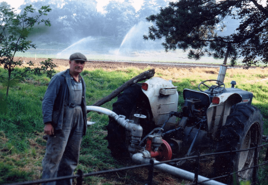 Tom Bassett with a new irrigation system, circa 1975.