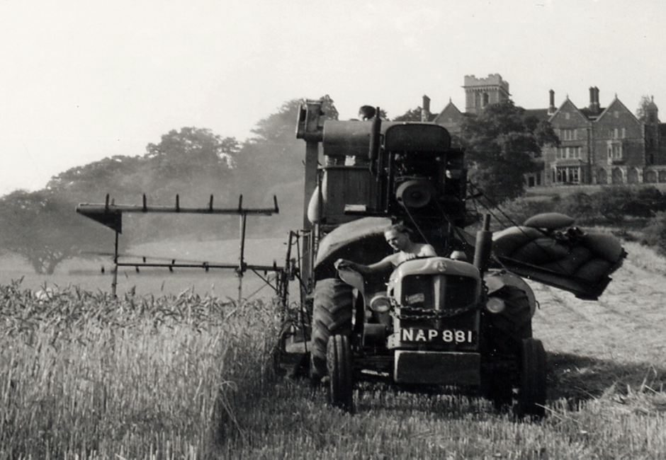 Harvesting under Nutfield Priory Hotel with an old bagger combine